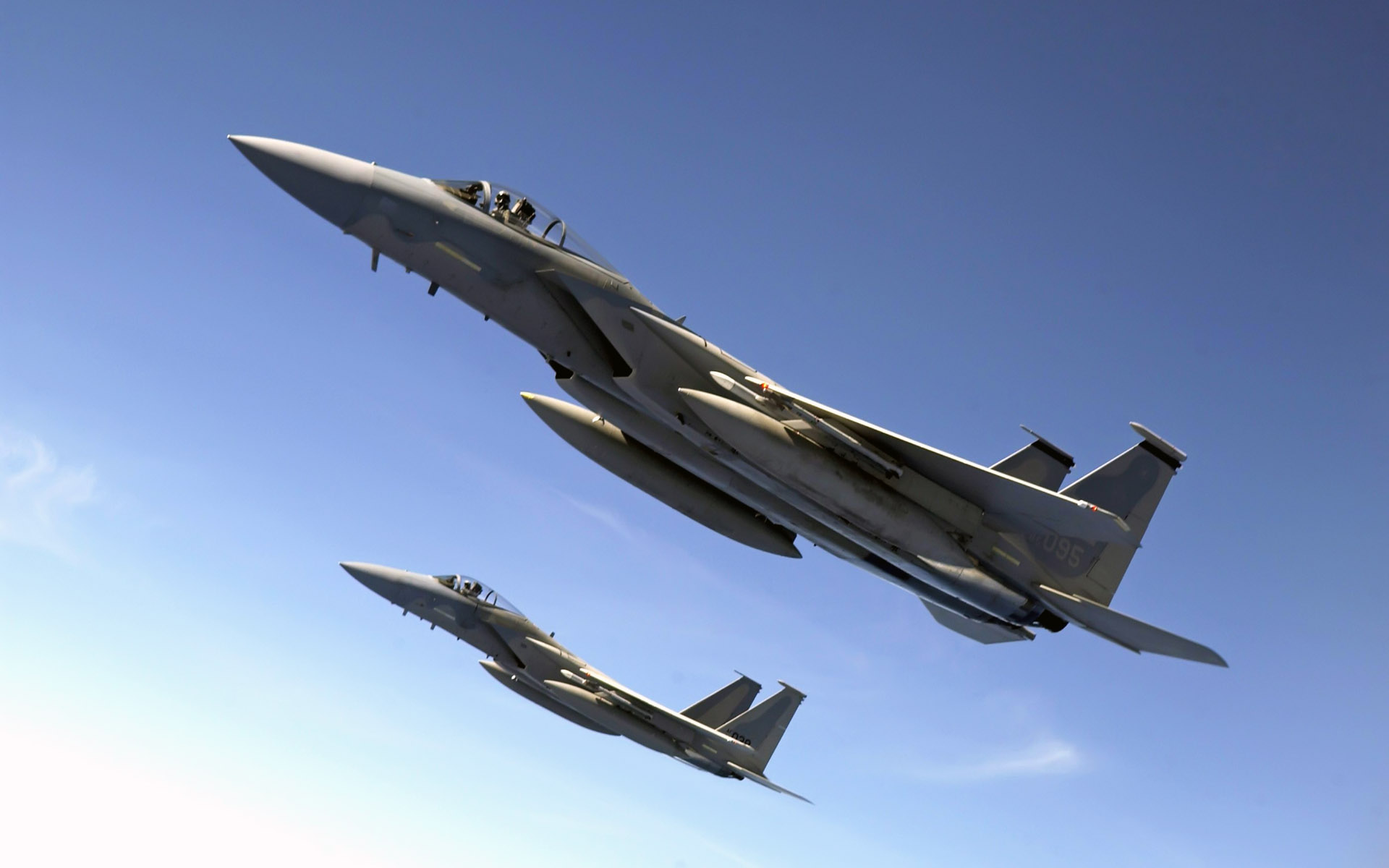 f 15 eagles fly over the pacific ocean wide