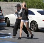 23708563_Miley-Cyrus-in-Shorts--13-662x6